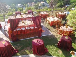 Red table linens and drapery rentals